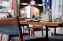 city-restaurant-table-pavement-medium